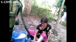 Bangla desi shameless village cousin-Nupur bathing outdoors (X-Cams.Org)