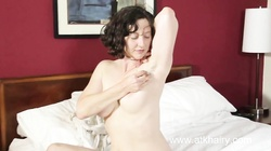 Artemis fucks her hairy pussy with a toy