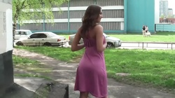 Russian girl poses nude in the streets