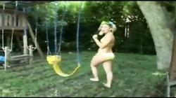 Yellow Bikini teen flashes pussy