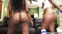 Awesome ebonies with big round asses demonstrating their oiled bodies