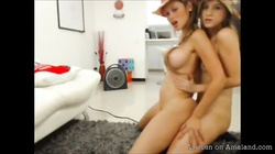 Two horny as fuck ladies are playing with their boobies and strapon