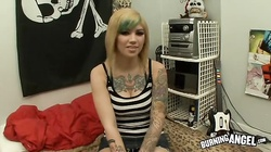 Tattooed punk blonde is getting fucked by couple of lesbians with strapons
