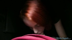 Redhead is performing an awesome blowjob for a Public Agent in toilet