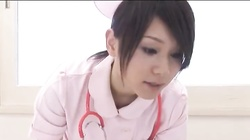 Dark-haired Asian nurse is taking his dick in the mouth