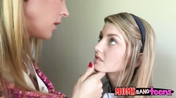 Teenager with eyes full of innocence being seduced by lusty milf