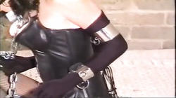 Short-haired brunette is being roped by her brutal master