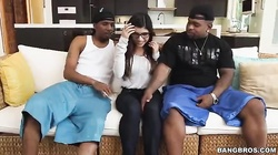 Two blacks are seducing and fucking a slender busty Latina Mia Khalifa