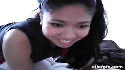Naughty asian school chick is playing with huge dildo in her butts