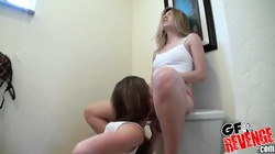 Sexy young lesbians are playing with pussies of each other in toilet