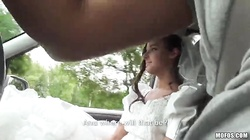 Tanned bride is spreading her legs and taking a dick